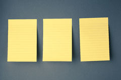 Three sticky papers on the wall Stock Image