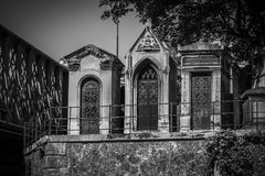Three Stone Family Mausoleums in Black and White Royalty Free Stock Photo