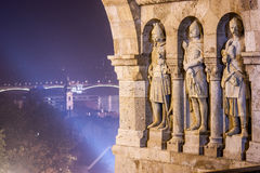Three stone guardian statues of Fisherman`s Bastion, in Castle district, Budapest, Hungary. Three stone statues guarding top of stairway to Fisherman`s Bastion Stock Photography