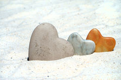 Three Stone hearts in the sand Royalty Free Stock Photo