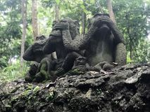 Three monkeys statues which have different posts. Cambodia stock photo
