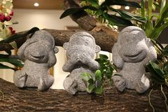 Three stone sculpture of the monkey, sitting in the tree, the performance can not be seen, can not hear, can not say, a symbol of. This photo shows the taste of Stock Image