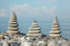 Three stone stacks on pebble beach Stock Photography