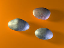 Three stones. Three oval shaped stones on a warm colored surface. Digital illustration Stock Photo