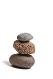 Three stones balanced. Isolated on white background Royalty Free Stock Photos