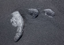 Three stones in the black sand Royalty Free Stock Photography