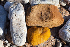 Three stones of different colors Stock Images