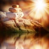 Three stones lighted bright sun Royalty Free Stock Photo