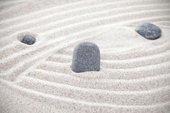 Three stones in sand, zen concept Stock Images