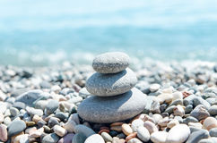 Three stones on stack near sea Stock Image
