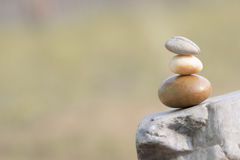 Three stones standing on one another symbolize balance Royalty Free Stock Image
