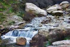 Three stones with a waterfall. Three big stones with a waterfall of a small river in Spain Stock Image