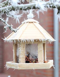 Three-storey bird feeder on a tree in winter. Stock Photography