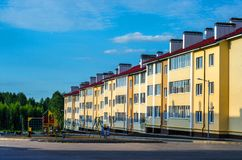 Three-storey elite residential complex with a children`s and sports ground in the courtyard stock photos