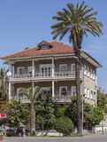 Three Storey House. A three storey house covered with a palm tree in front in Antalya, Turkey stock image