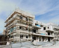 Three-storeyed apartment building under construction Stock Photo