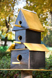Three-storeyed birdhouse Stock Photography