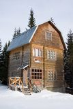 Three-storeyed wooden house concealed by snow Stock Photos
