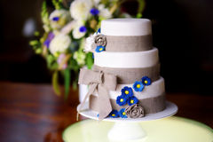 Three stories wedding cake decorated with blue flowers Stock Photography