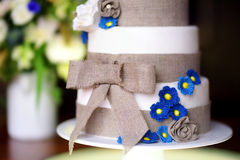 Three stories wedding cake decorated with blue flowers Stock Image