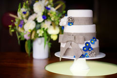 Three stories wedding cake decorated with blue flowers Royalty Free Stock Image