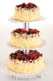 Three-story cake almond with red berries Stock Photos