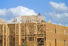 Three Story Construction. Two story frame condos under construction showing green wood on first floor and construction slab Stock Photography