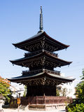 Three story pagoda of Hida-Kokubunji temple in Takayama, Japan. Takayama, Japan - October 6, 2015: Three storied pagoda of Hida Kokubunji buddhist temple Stock Photos