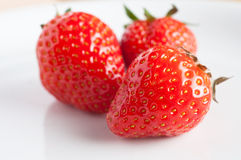 Three Strawberries Stock Photography