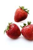 Three strawberries. Close-up of strawberries on white royalty free stock photo
