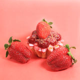 Three strawberries and cherry cake Royalty Free Stock Photo