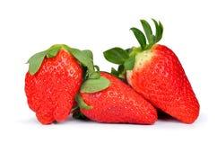 Three strawberries Stock Photos