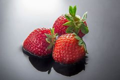 Three strawberries Stock Image