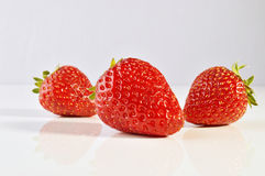 Three strawberries. Royalty Free Stock Photo