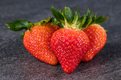 Three strawberries on gray stone Royalty Free Stock Image