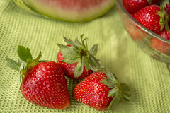 Three strawberries in Huelva on a green tablecloth. Stock Images