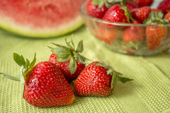 Three strawberries in Huelva on a green tablecloth. Royalty Free Stock Photos