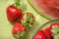 Three strawberries in Huelva on a green tablecloth. Stock Photos