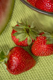 Three strawberries in Huelva on a green tablecloth. Stock Photography