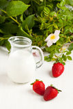 Three strawberries with milk Stock Photo