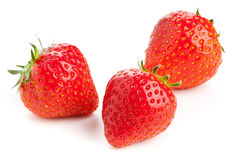 Three strawberries over white background Royalty Free Stock Image