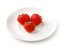 Three strawberries on the plate Stock Photo