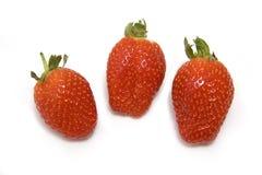 Three strawberries on white Stock Photography