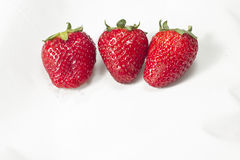 Three strawberries on a white background Stock Photo