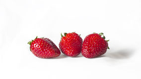 Three strawberries on a white background Stock Image