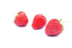 Three strawberries on a white background with shadow Stock Image
