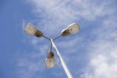 Three Street Lights on a Pole. Royalty Free Stock Photo