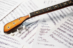 Three string balalaika fingerboard. On the note background stock images