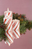 Three striped Christmas candles soft background Stock Photography