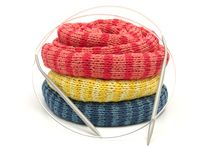 Three striped reeled up knitting scarfs Royalty Free Stock Photography